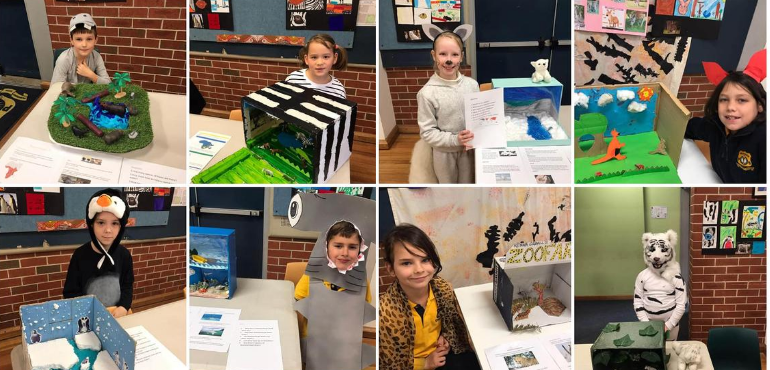 students displaying their zoofari work